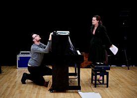 Sian and Tom hiding at piano